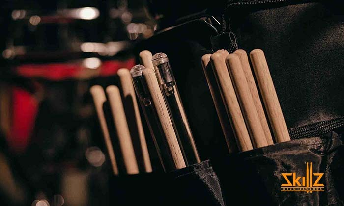 drum sticks on a drum bag