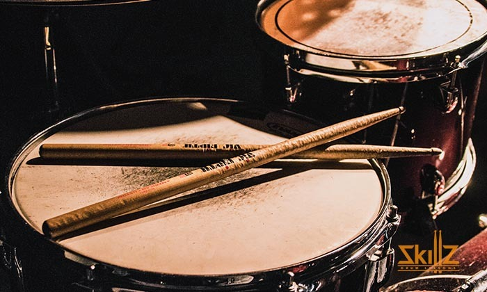 Drum sticks on top of snare drum