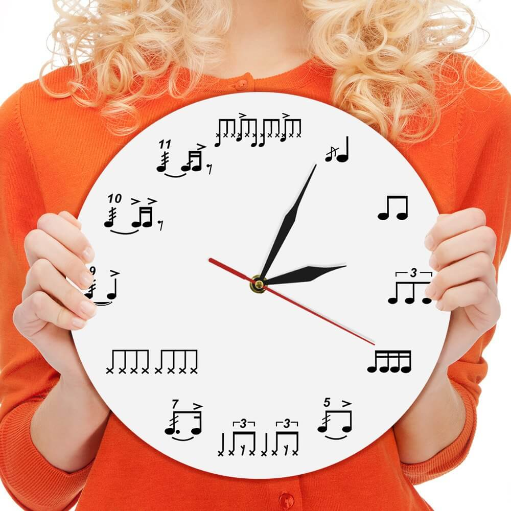 Picture of a lady holding a clock indicating the Daily Drum Diet by Skillz Drum Lessons